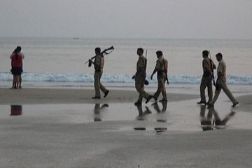Police patrol an Indian beach