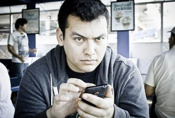 Angry person using cellphone