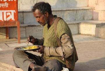 A homeless man having a meal