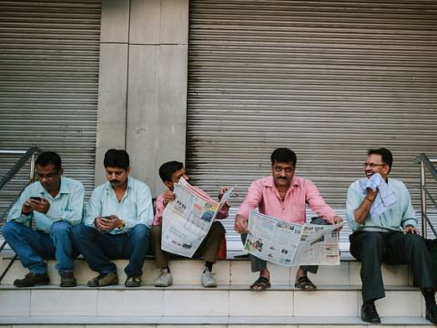 Indians engaged in catching up with the news