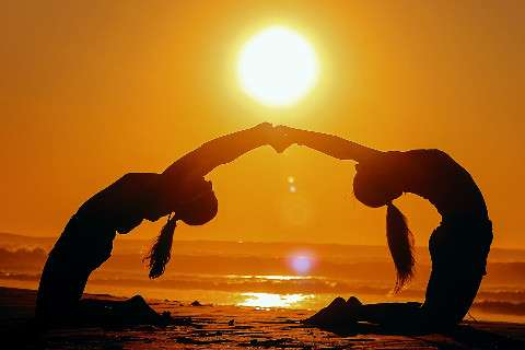 Yoga with a friend helps to attain goals